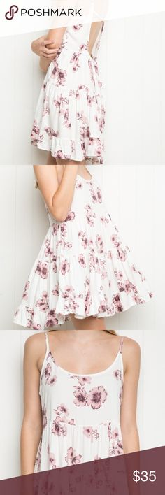 Brandy Melville Jada Floral Dress Rare flowy floral Jada dress from Brandy Melville. It is a one size fits all with an open back. Tiny rust mark on the back of one strap (pictured) that is barely noticeable, but other than that is in great condition. Brandy Melville Dresses Mini
