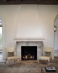 antique stone mantle living room of Lynnstone estate in Jackson, Mississippi. Interior Designer Annelle Primos of Jackson. Architect Kevin Harris of Baton Rouge. image via cote de texas