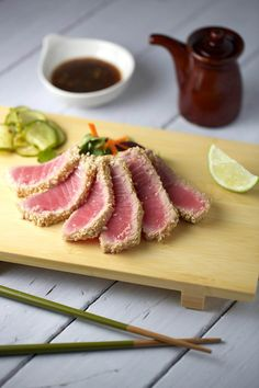 Sesame crusted ahi tuna with soy ginger sauce - a healthy and very simple dish to make! Pickled cucumbers add a sweet and tangy crunch with…