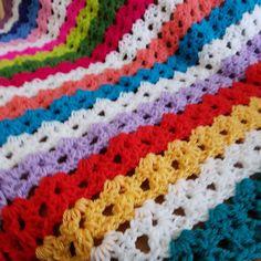Working on a new v stitch stripe crochet blanket today.
