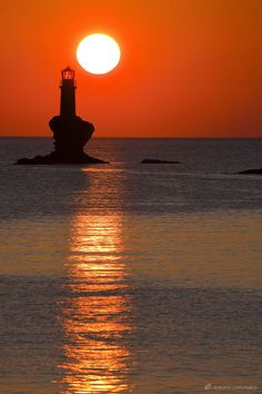 Tourlitis Lighthouse Sunrise in Andros island Cyclades, Greece Andros Greece, Lighthouse Keeper, Lighthouse Art, Greek Islands, Places To Travel, Scenery, Around The Worlds, Ocean, Landscape