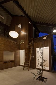 Japanese house with seven house-shaped blocks sheltered beneath one large roof.