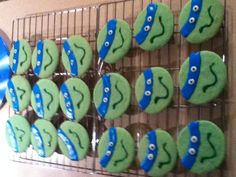 Teenage Mutant Ninja Turtle cookies. Betty Crocker sugar cookie mix dyed green, the I used Betty Crocker blue cookie icing for the headband. I cut them out using my egg shaped cookie cutter.