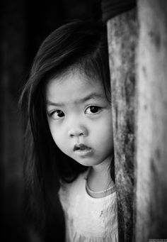 In the book, Hà is a little Vietnamese girl who has dark, straight, short hair. She wished for long hair her whole life.