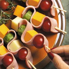 Ham & Cheese Ribbons Ingredients: 6 (1/2-ounce) slices smoked deli ham 24 (7 to 8-inch) wooden party skewers 1 (8-ounce) Cheddar Cheese, cubed 3/4-inch 1 (8-ounce) Monterey Jack Cheese, cubed 3/4-inch 1 pint (24) small cherry tomatoes 8 baby dill pickles, sliced 1/2-inch Country-style Dijon mustard