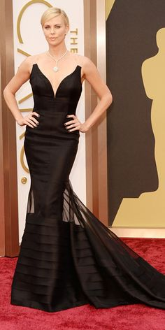 #Oscars #2014 Red Carpet Arrivals - Charlize Theron is exquisite in black. #RedCarpet #BestDressed via InStyle