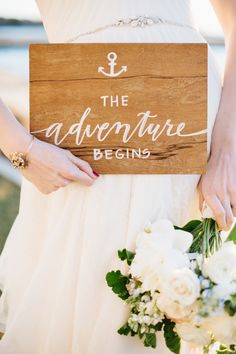 """The Adventure Begins"" sign"