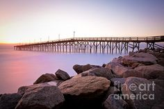 Beach Fishing Pier and Rocks at Sunrise Photograph by Jo Ann Tomaselli - Beach Fishing Pier and Rocks at Sunrise Fine Art Prints and Posters for Sale jo-ann-tomaselli.artistwebsites.com #joanntomaselli #fineartphotography #landscapephotography