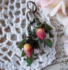 Brass, Green Five Sprig Leaf with Two Roses Dangle via Etsy