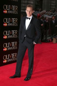 Tom Hiddleston arrives at The Laurence Olivier Awards 2013 at The Royal Opera House on April 28, 2013 in London, England