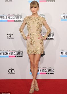 Going for gold: Taylor Swift was hoping to win big at the American Music Awards on Sunday in her stunning dress