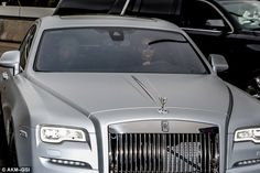 Arriving in style: Kim was easy to spot, driving her flashy silver Rolls Royce