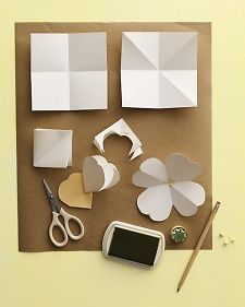5. Use a starburst-style stamp to mark center. Cut out leaves from green card stock. Secure flowers and leaves to branches with clear craft glue.