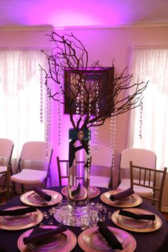 #unique #centerpieces #purple love the #puplelights in the back groud.  Reception at Special Moments Wedding Chapel