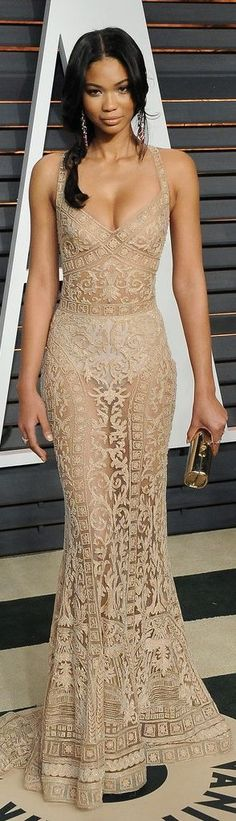 Chanel Iman in a sheer nude lace dress at the Vanity Fair Oscars afterparty
