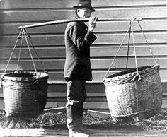 A Chinese laborer most likely transporting fresh vegetables to market in 1888. / Courtesy of Oregon Historical Society