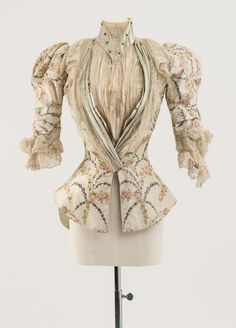 House of Worth, 1890s Bodice of cream and pale blue silk, warp printed in a rosebud design Worn by Mary Chamberlain Carnegie Fashion Museum Bath