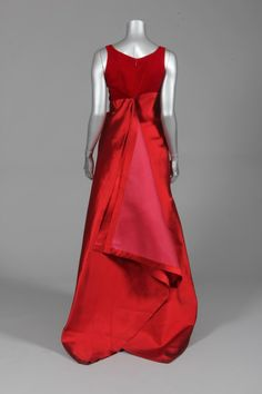 Gianfranco Ferre for Christian Dior couture scarlet velvet and gazar evening gown, 1996, with V-shaped high waisted bodice, deep centre pleats to the skirt front, the rear skirt falling in long origami-like pointed pleats