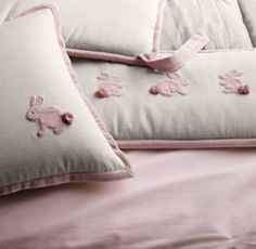 RH baby&child's Appliquéd Velvet Bunny Crib Bumper :Ever-gentle baby bunnies frolic on a softly textured field of cotton and linen. Crafted from lush cotton velvet appliqués, each is finished with a puffy pom-pom tail for added texture and dimension.