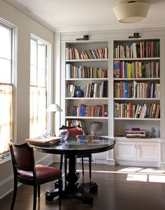 Dining tables can also serve other purposes if we think slightly outside the box. This small, round dining table in a study is great for gam...