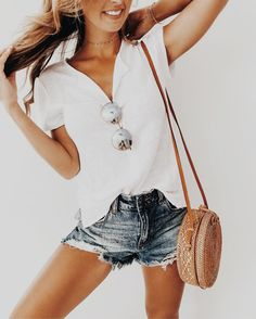 The definition of a summer outfit! White tee shirt and cut off shorts