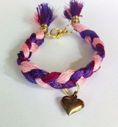 Pink and purple braided friendship bracelet by BeadingByJenn #jewelry #braidedbracelet #friendshipbracelet #pink #purple #heartbracelet #handmadejewelry #beadingbyjenn #etsy #accessories #girls #teens #womens