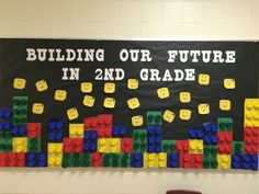 Lego bulletin board for welcoming students back! Made out of plastic cup ends!
