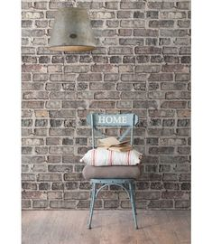 """We love our realistic wallpaper in """"Vintage Bricks"""" for an authentic brick wall."""