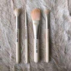 Authentic MAC Brushes Set Christmas Edition MAC brushes. The right two brushes were used a handful of times, the other two were never used. They are all in excellent condition! All brushes will be cleaned thoroughly before given. MAC Cosmetics Makeup Brushes & Tools