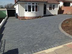 Grey block-paved driveway (charcoal blocks )