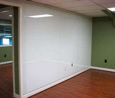 Full whiteboard wall for office/studio.  Add curtain on track to conceal.