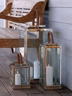 Galle-Lanterns-Satara Material: Stainless Steel / Timber / GlassFinish: NaturalUse: Display or Candle HolderAdd a candle, vertical plant, collection of shells o