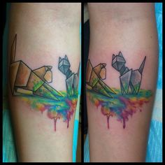 Origami cat tattoo on forearm with some watercolor embellishments!  By Michelle Carter at 1001 Troubles Tattoo Studio
