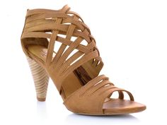 J SHOES-Fervor by J Shoes. An open toe, heeled sandal featuring a woven leather upper. Multiple feminine straps wrap around the foot. The complimenting heel stack and the embossed leather sole add a crafted finish to this style. The perfect summer sandal.
