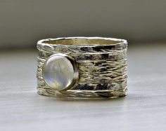 This sterling silver stackable rings set features an eye catching 8 mm milky moonstone.  Stack and mix 'n match these 5 rings that have been been hammered and buffed to a beautiful shine!    Bespoke & stylish, I will make this elegant ring with contemporary lines in any size, including half and q...