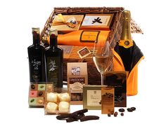 This extraordinary gift has everything you need for an evening of entertainment and style. Veuve Clicquot (with an ice jacket, to keep this and future bottles cool and ready), Godiva chocolates, marzipan, olive oil, Belgian chocolates and more.