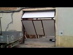 NEW OVERLAP SILVELOX THE FIRST SECTIONAL GARAGE DOOR WITHOUT CEILING TRACKS - YouTube
