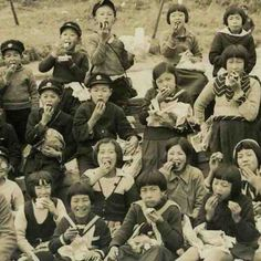 Vintage Japanese photograph of schoolchildren eating. The photo dates from the early to mid 20th century.