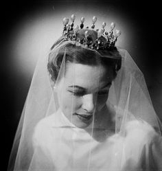 A model wears a tiara of large drop pearls and brilliants, over her veil. Exquisite