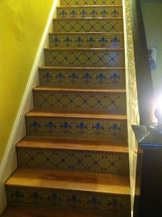 Stenciled faux tile on stair risers.