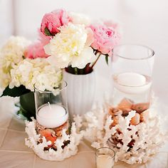 Peonies, hydrangeas, and candles in coral-wrapped vases. Photo: KT Merry.