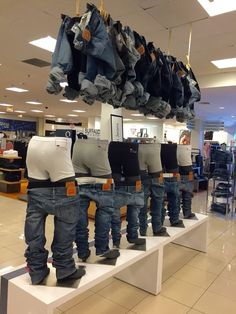 This is a Levi's display in Macy's. It is a very good way to display multiple items at once, the underwear, and multiple jeans. It is unique enough to draw attention, increasing potential sales. Fashion Retail Interior, Clothing Store Interior, Fashion Showroom, Showroom Design, Shop Interior Design, Retail Design, Store Design, Fashion Store Display, Clothing Store Displays