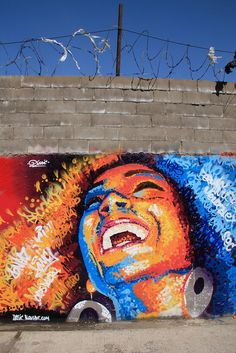 dasic '10 - kinda weird juxtaposition between her joy and the barbed wire running the wall