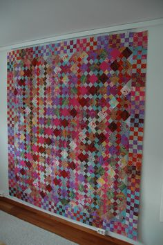 Four patche and nine patch squares beautifully combined.