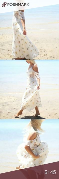 """NWT FREE PEOPLE OCEAN BREEZE MAXI SZ 0 Light and flowy maxi dress perfect for summer!  V-neck & v-back.  Short sleeves with lace cuffs.  Shoulder cutout with scallop trim.  Lace neck trim.  Allover floral print.  Lined.  Approx. 53"""" length   Bust: 34"""" Waist: 24""""  Hips: 34""""           anthropologie, for love and lemons, spell, boho, Indah, raga, tularosa Free People Dresses Maxi"""