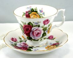 Royal Albert, Teacup & Saucer,Beautiful Floral Pattern, Gainsborough Shape, Gold Rims, Bone English China made in 1960s.