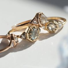 A bold ring fit for a bold queen.  solid 18k yellow gold 1.15 ct gray rose cut center diamond .38 carat salt and pepper trillion sides 1.53 total carat weight one of a kind