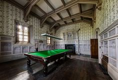 While photographing an abandoned manor house, urban explorer Dan Raven came upon this beautifully preserved billiard room complete with what appears to be a full size snooker table.