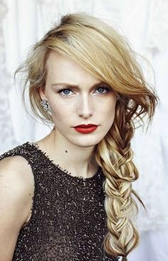 Love her side braid, and her red lips.