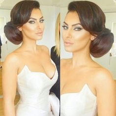 Im not a fan of updo's for weddings, but this is gorgeous; As well as the makeup.